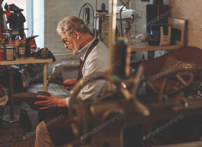 Elder cobbler at work