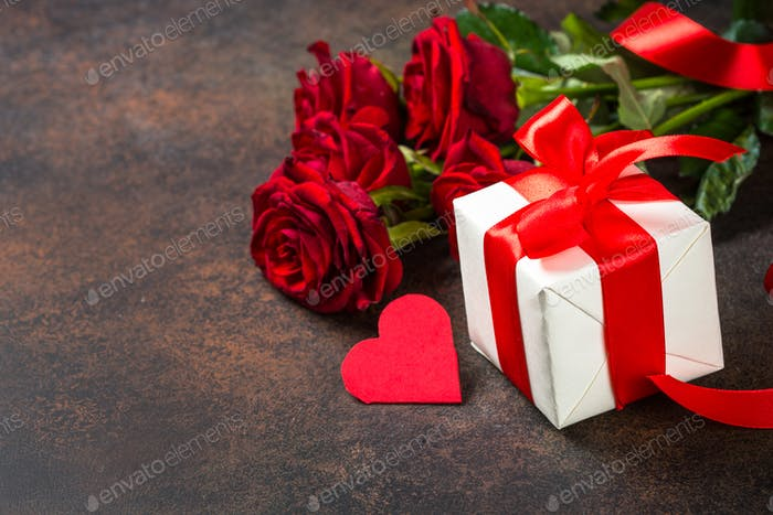 Holiday background with Valentine, present and flower.