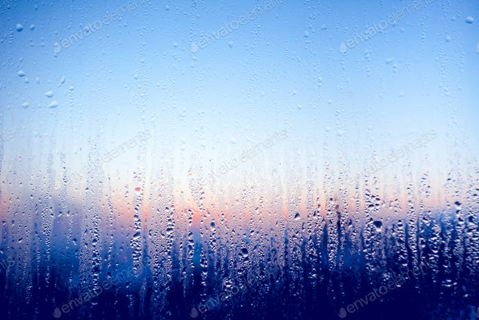 Clear water drops on the glass window. Background.