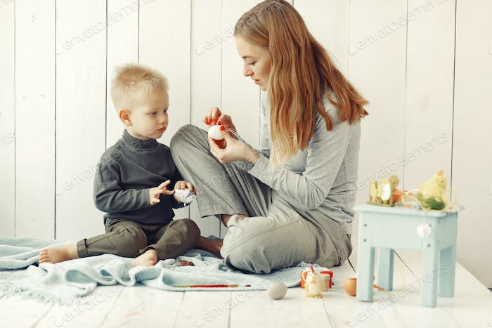 Mother with son at home prepare to easter