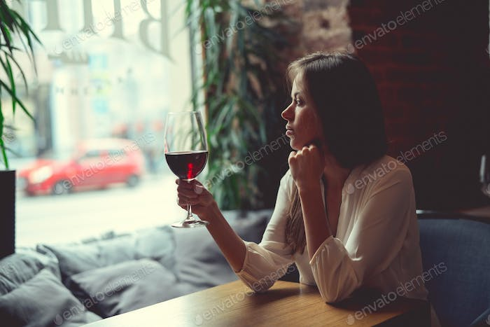 Young girl with a glass of wine