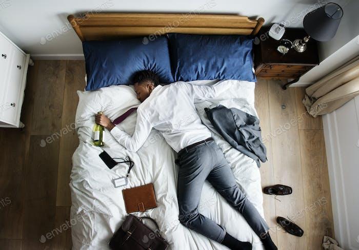 Drunk African American business man falling asleep as soon as he