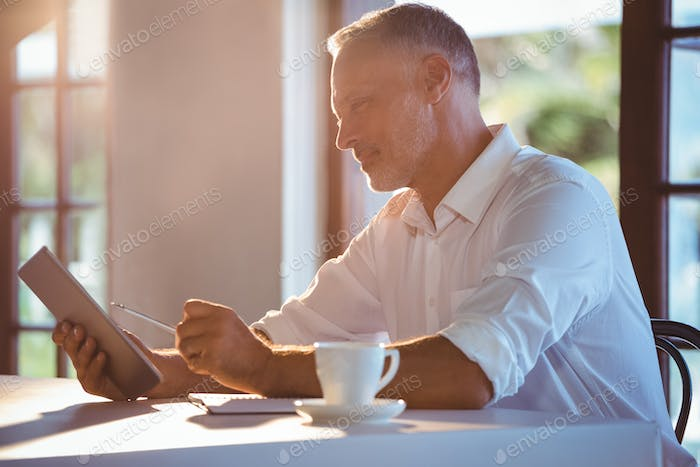 Man using tablet and notebook