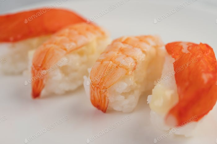 Sushi is beautifully arranged on the plate.
