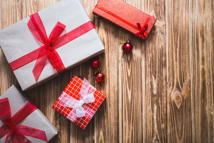 Christmas gift boxes on a wooden background