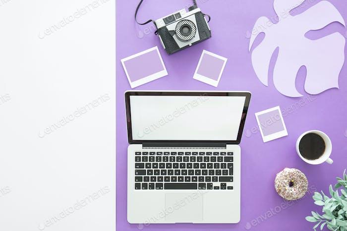 Laptop on purple background