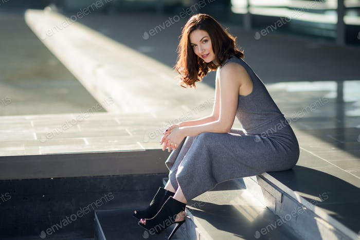 Young woman wearing casual clothes in urban background