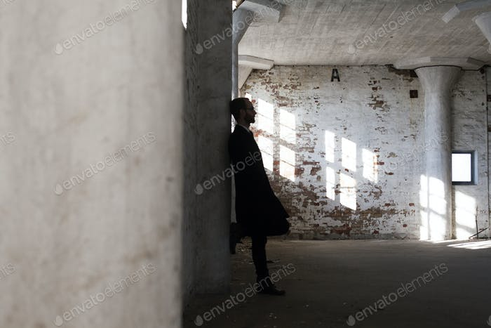 Lonely businessman in abandoned building