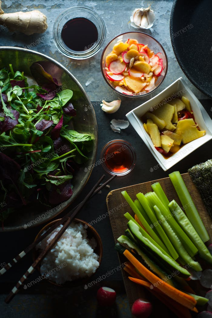 Wok, rice and vegetables for cooking sushi top view. Asian cuisine