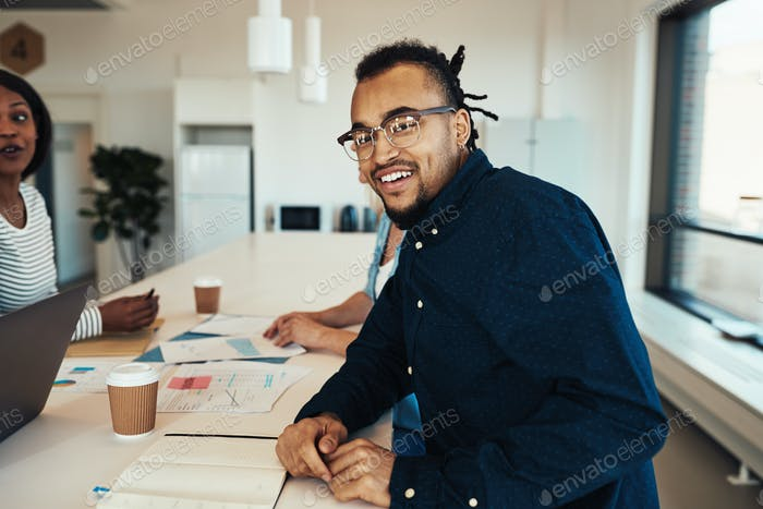 Young African American office worker smiling during a meeting