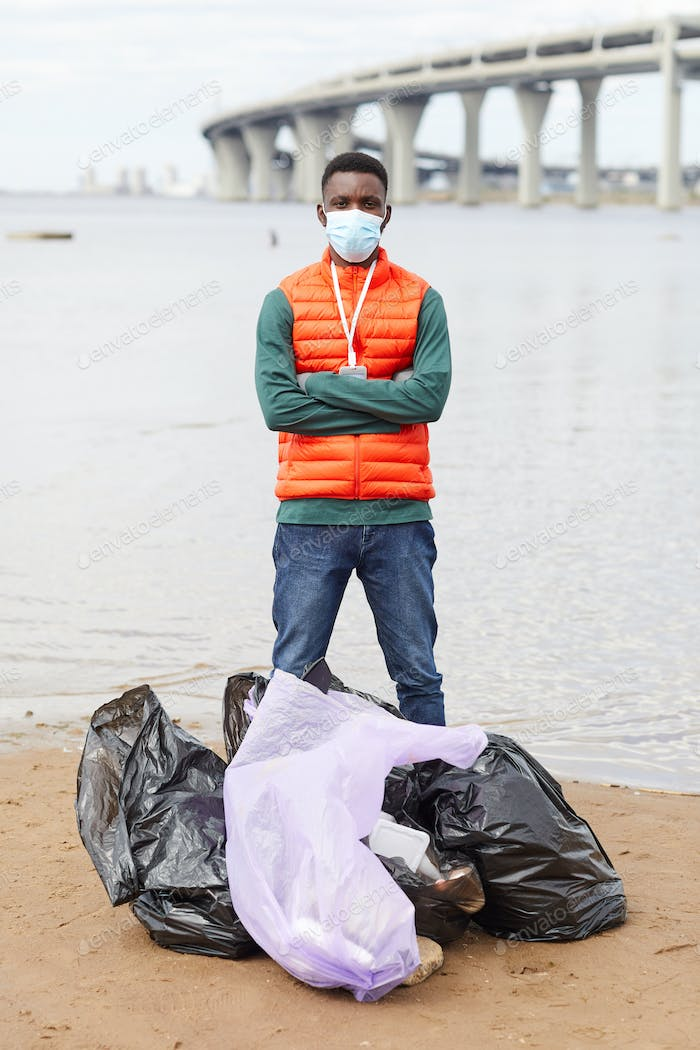 Man cleaning the coastline