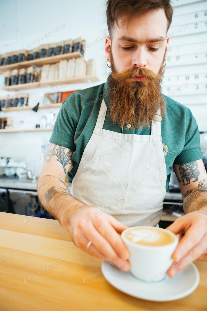Handsome man preparing coffee
