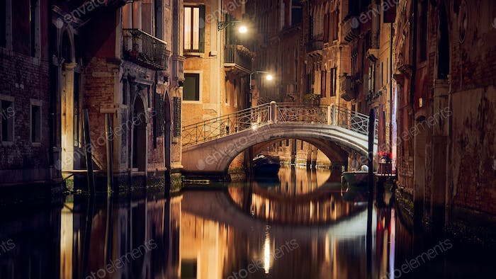 Bridge on a canal at night in Venice