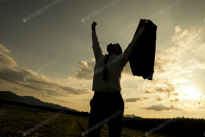 Silhouette of a businessman raising his arm