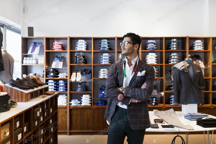 Tailor standing in clothing store