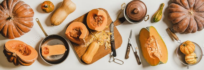 Flat-lay of cleaning and cooking pumpkin on wooden board