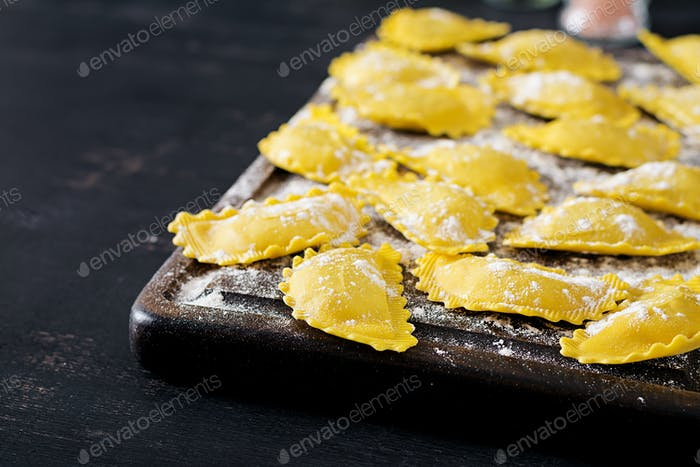 Uncooked ravioli on table. Italian cuisine.