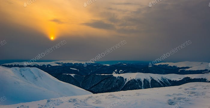 Mystical view of snowy hills in mountain valley
