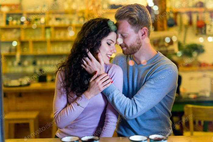 Romantic couple having date in coffee shop