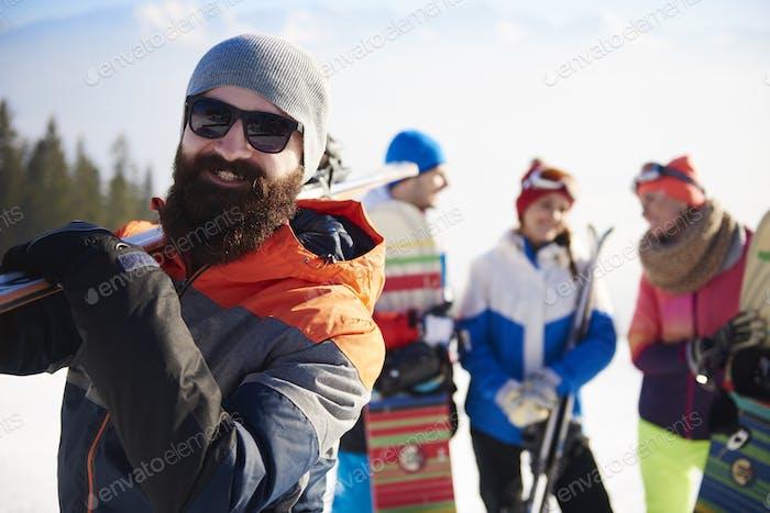 Bearded man with ski equipment