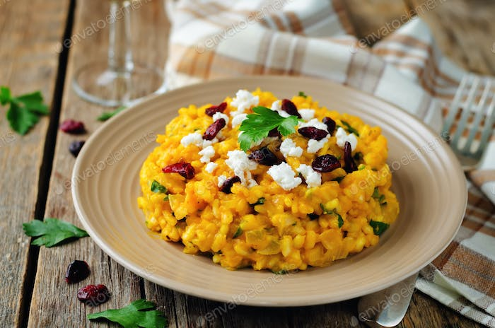 Pumpkin risotto with dried cranberries and goat cheese