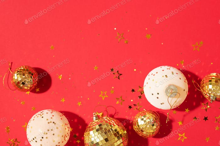 Christmas white and gold decorations, mirror disco balls, star sparkles over red background. Flat