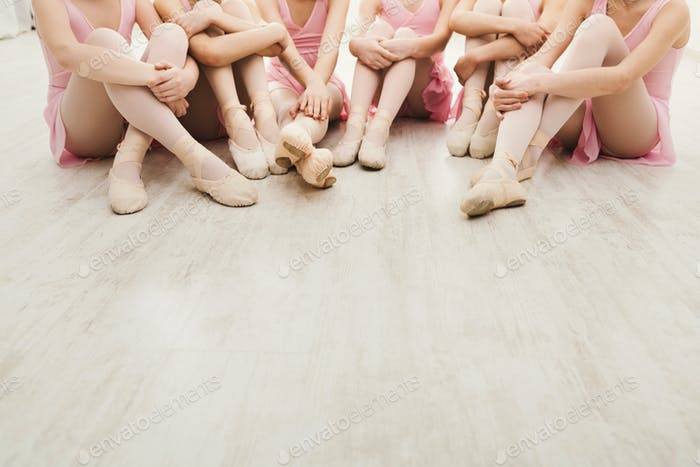 Little ballerinas talking in ballet studio