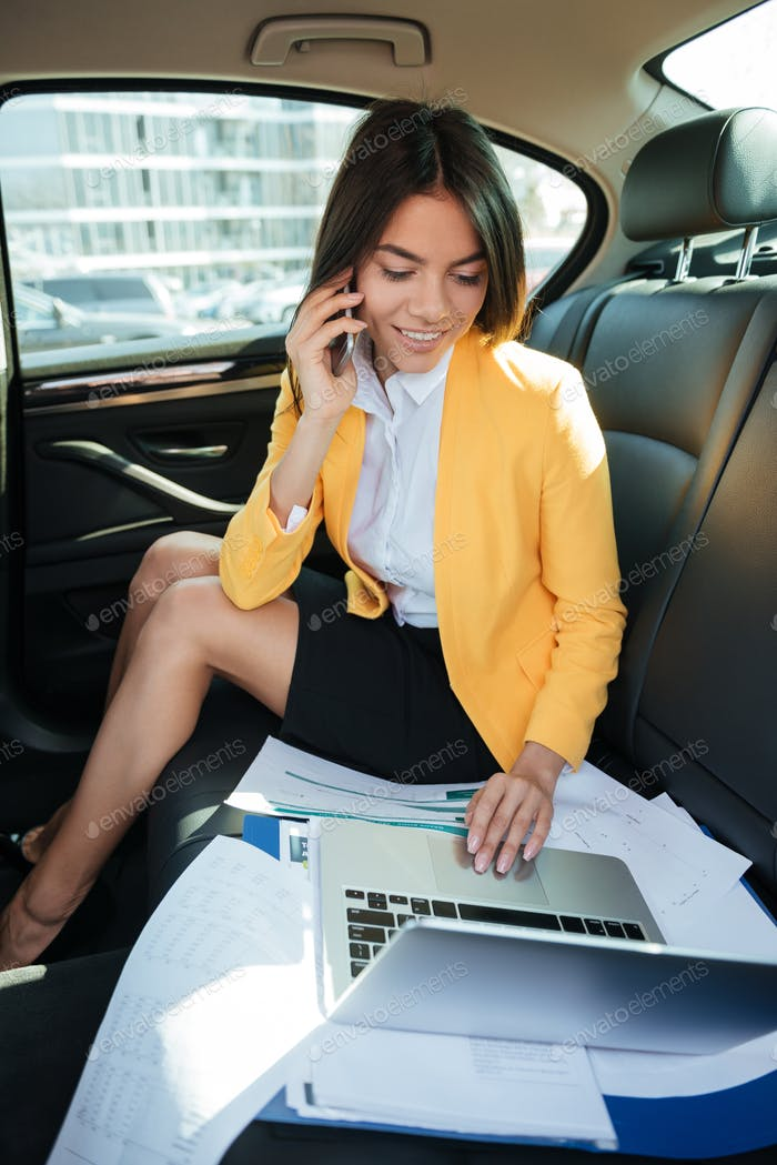 Portrait of a young business woman talking on mobile phone