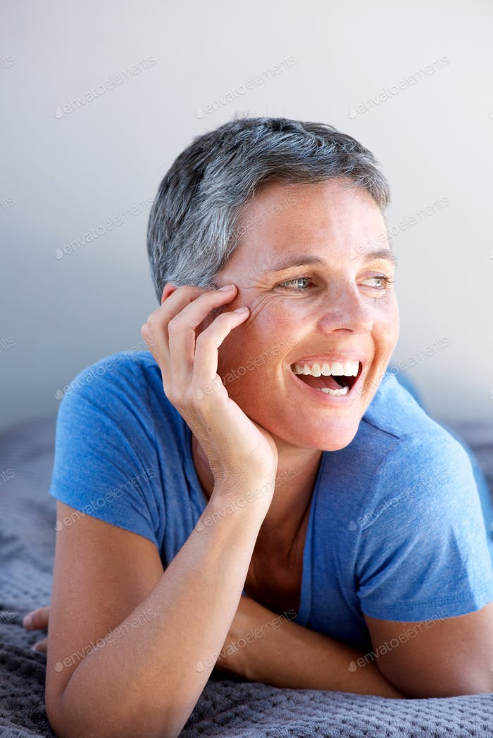 Close up beautiful mature woman relaxing and smiling