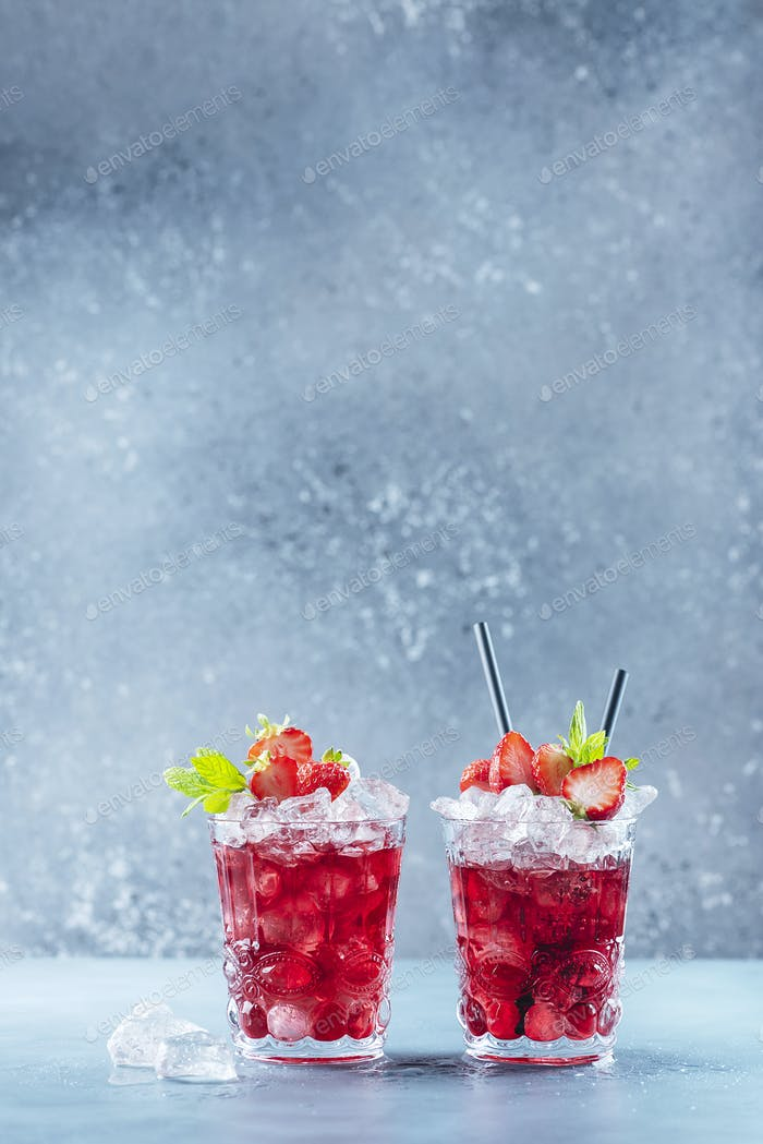 Red cocktail with ice and mint