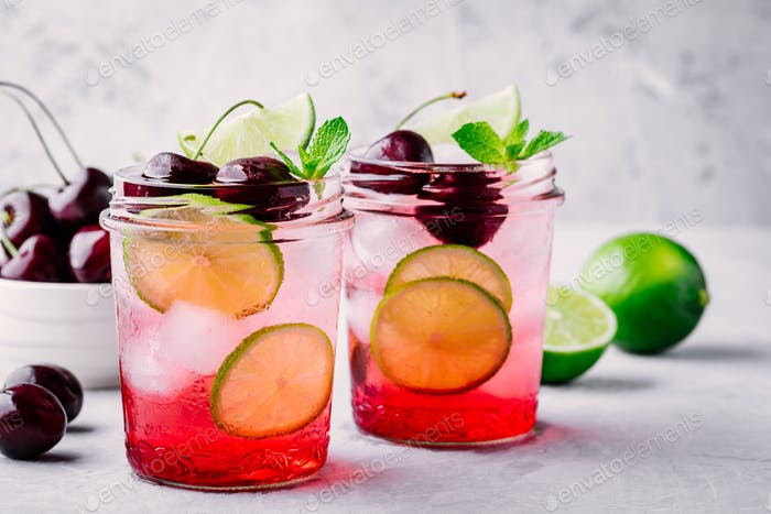 Refreshing cold summer drink cherry and lime lemonade