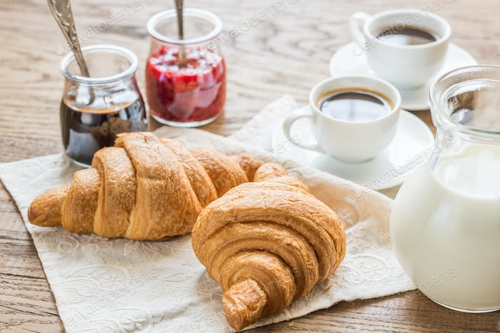 Croissants with cups of coffee