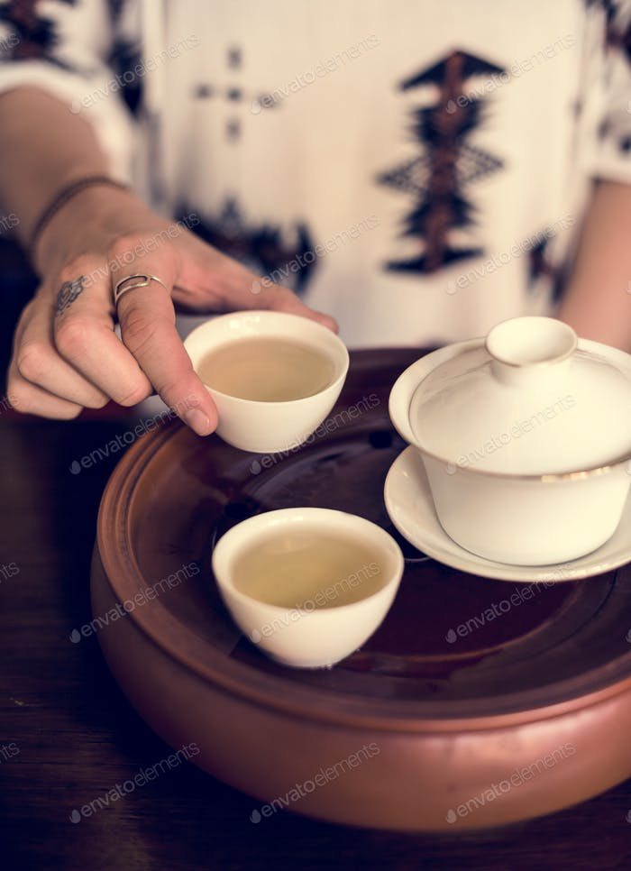 Young Woman Drinking Tea Concept