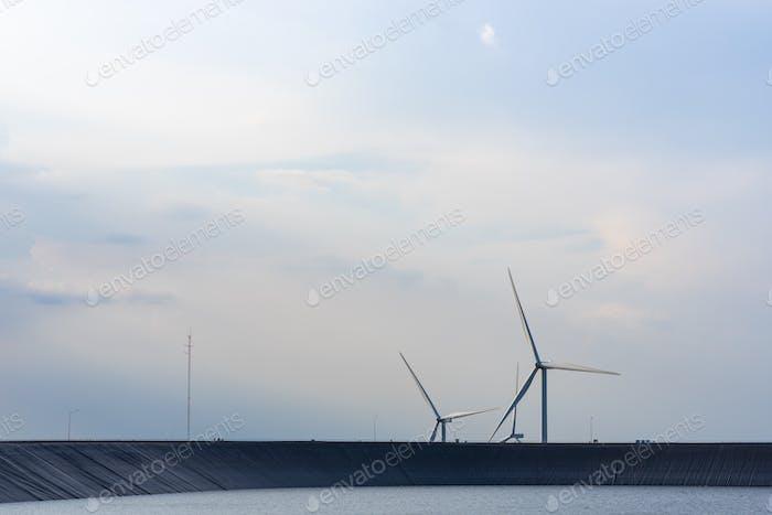 The wind turbine power working, blue sky, energy power concept