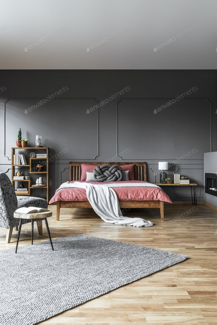 Spacious grey bedroom interior