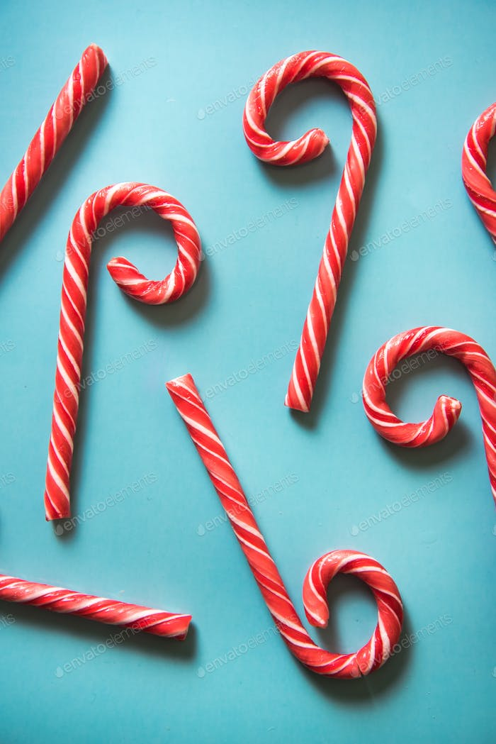 Christmas festive candy canes on pastel background