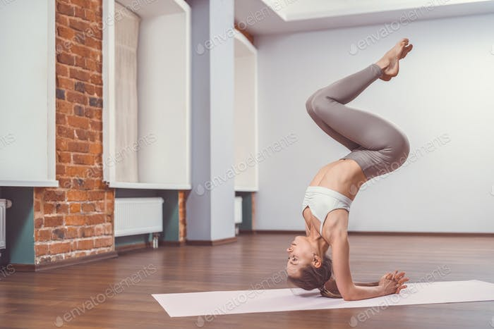 Attractive young girl in yoga class