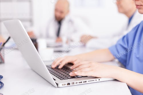 Medical practitioner typing diagnosis