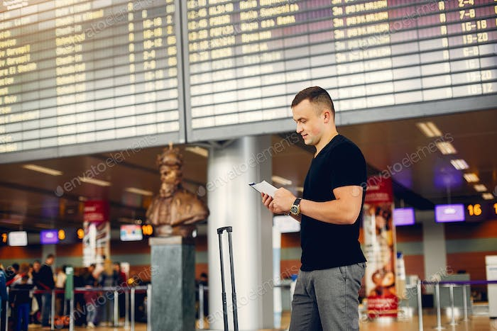 Handsome man standing in a airport