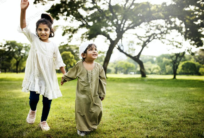 Muslim kids running in the park