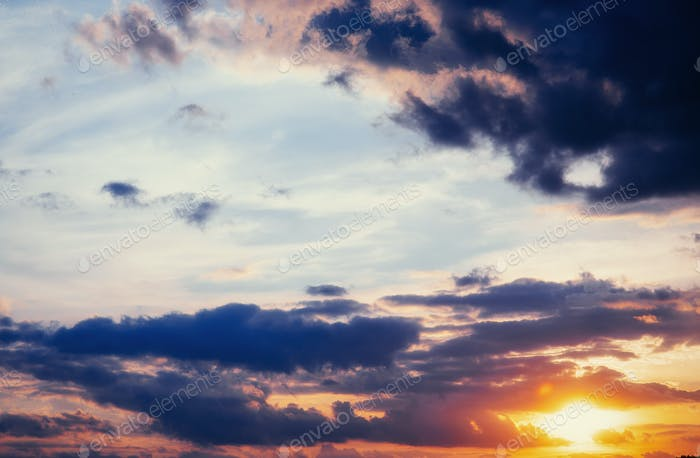 cumulus clouds at sunset.