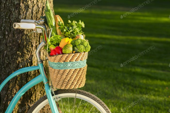 Fruits and vegetables in basket on a bicycle