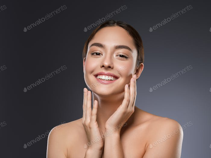 Teeth smile happy woman beauty face hand touching face