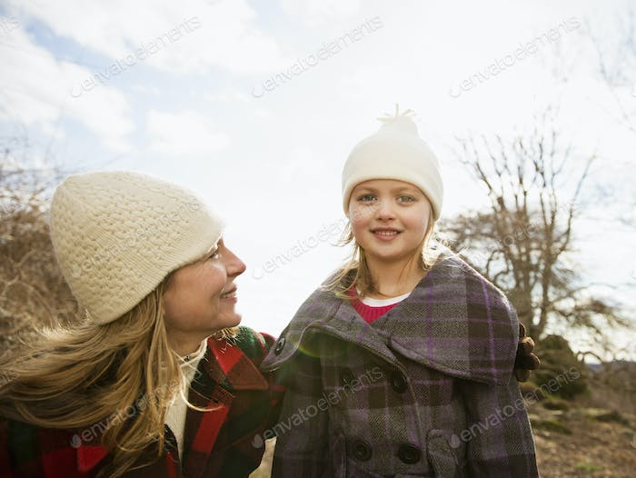 A woman and child wrapped up against the cold weather.