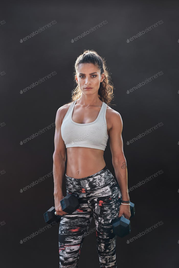 Fitness woman exercising with heavy weights