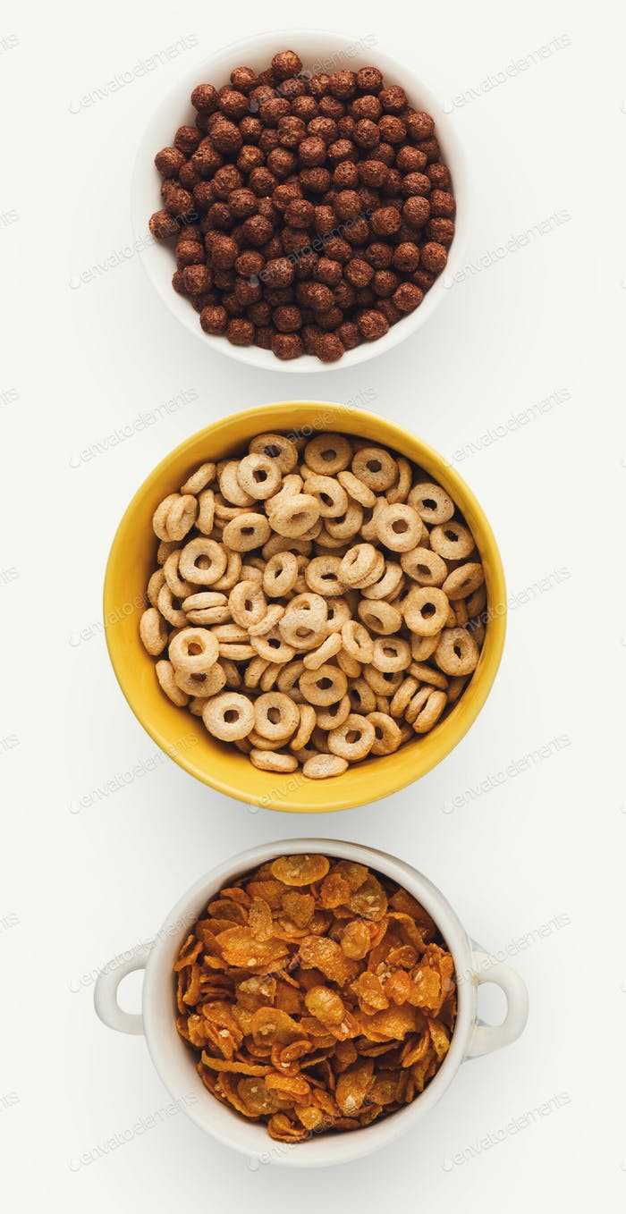 Set of bowls with quick breakfast cereals, isolated
