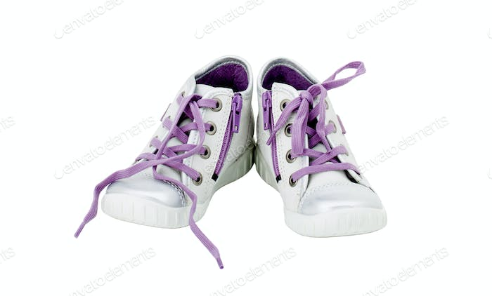 White leather sneakers with purple shoelace.
