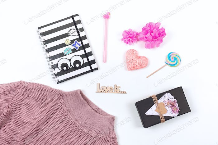 Valentines day pastel minimal flat lay. Pink sweater, notepad, pen, heart, gift, lollipop and text