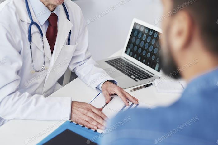Close up of doctor showing the results of the examination