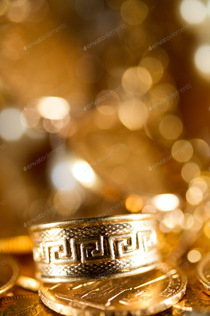Joyas y monedas de oro